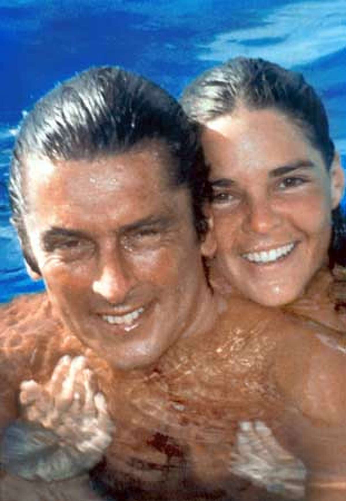 """Robert Evans (left) and Ali Macgraw in """"The Kid Stays in the Picture."""""""