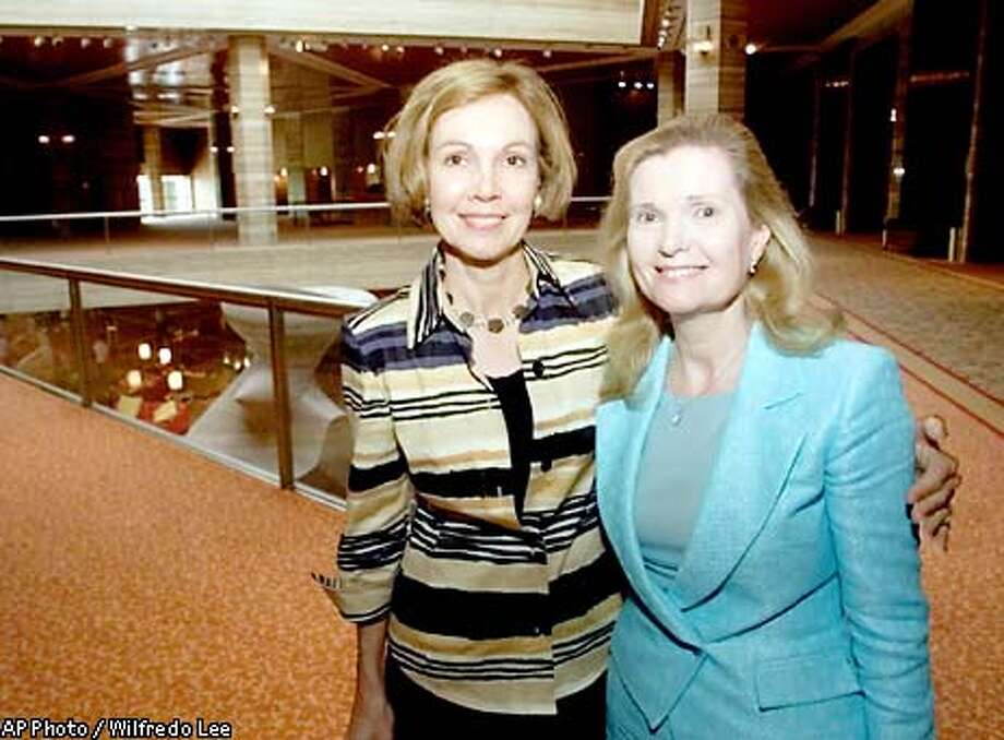 "Sisters Julie Eisenhower, left, and Patricia Cox, daughters of late President Richard M. Nixon, pose during a break in a mediation session Tuesday, Aug. 6, 2002 in Miami. The sisters are involved in a dispute over about $26 million in funding for the Nixon library and foundation from the estate of C.F. ""Bebe"" Rebozo. (AP Photo/Wilfredo Lee) Photo: WILFREDO LEE"