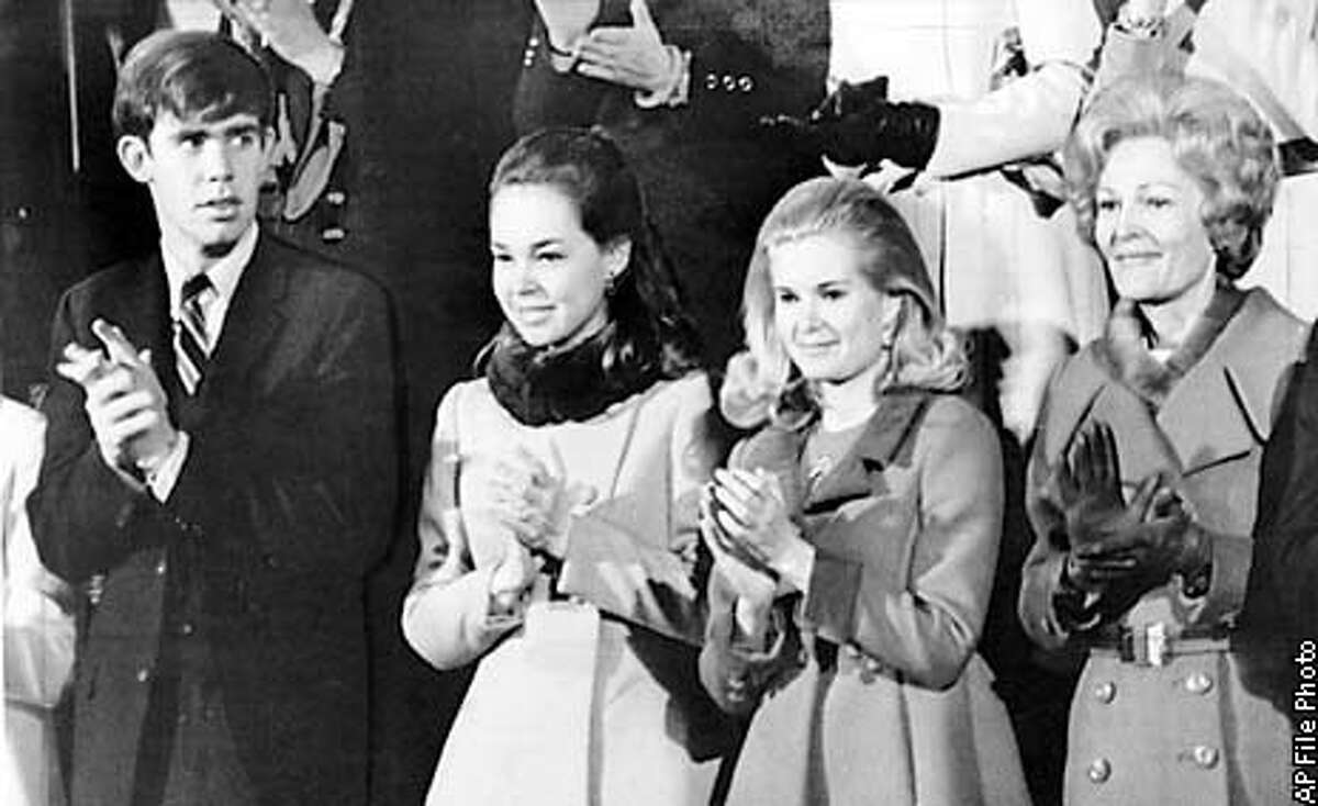 January 22, 1970. President Nixon's family applauds his State of the Union message from the gallery of the House of Representatives today. From left, David and Julie Eisenhower, Tricia and Mrs. Nixon. AP Wirephoto