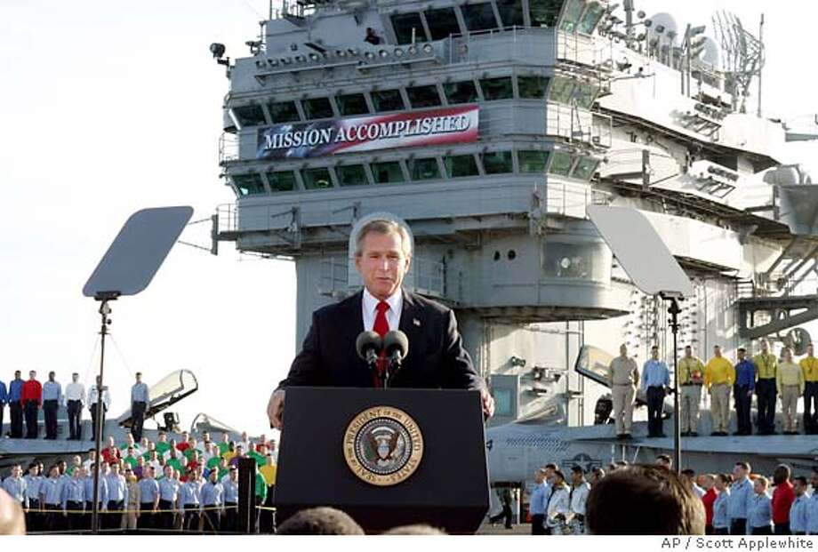 "President Bush declares the end of major combat in Iraq as he speaks aboard the aircraft carrier USS Abraham Lincoln off the California coast, Thursday, May 1, 2003. The carrier will arrive in San Diego May 2, 2003, following a record 10-month deployment including ""Operation Iraq Freedom."" (AP Photo/J. Scott Applewhite) Photo: J. SCOTT APPLEWHITE"
