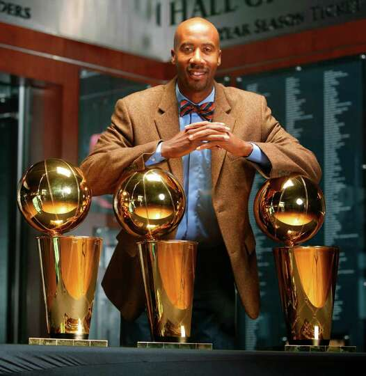 Bruce Bowen poses Wednesday Dec. 7, 2011 at the AT&T Center with the three Larry O'Brien Championshi