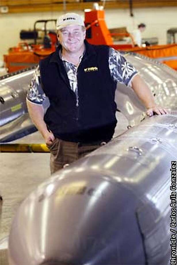Bill Wing in the shop with some Rigid Inflatable Boats at Wing Inflatables in Arcata, Ca., on Tuesday, August 6, 2002. Wing Inflatables has become one of the most unlikely defense contractors, supplying RIBs to the Navy Seals and other Navy groups. The RIBs are constructed from a Nylon-reinforced Polyurethane which withstands extreme wartime conditions, and can withstand bullet penetration if supported by an internal foam structure. This particular boat will be coated with a non-reflective coating for use by the Navy Seals.  (CARLOS AVILA GONZALEZ/SAN FRANCISCO CHRONICLE) Photo: CARLOS AVILA GONZALEZ