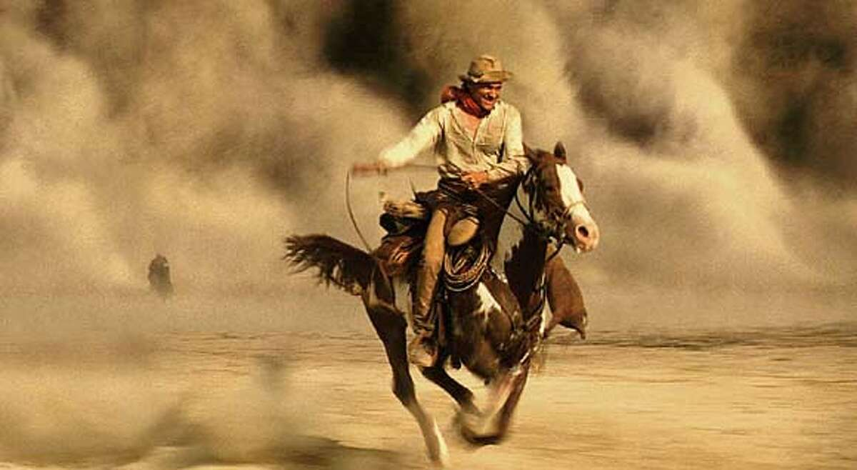 A stranger in a strange land, American distance rider Frank T. Hopkins (Viggo Mortensen, pictured) and his horse, Hidalgo, face many strange events including a sandstorm as they compete in the Ocean of Fire, a 3,000-mile race across the Arabian desert, in Touchstone Pictures action-adventure Hidalgo. (AP Photo/ILM)