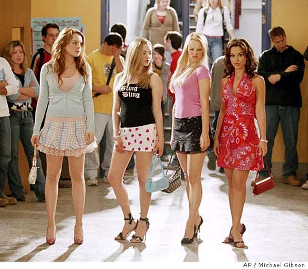 (Left to right) Lindsay Lohan as Cady, Amanda Seyfried as Karen, Rachel McAdams as Regina and Lacey Chabert as Gretchen in Mean Girls. (AP Photo/ Michael Gibson)