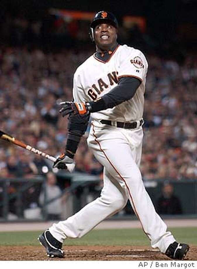 San Francisco Giants' Barry Bonds swings and misses on a pitch from Atlanta Braves' Jaret Wright in the third inning Tuesday, April 27, 2004, in San Francisco. (AP Photo/Ben Margot) Photo: BEN MARGOT