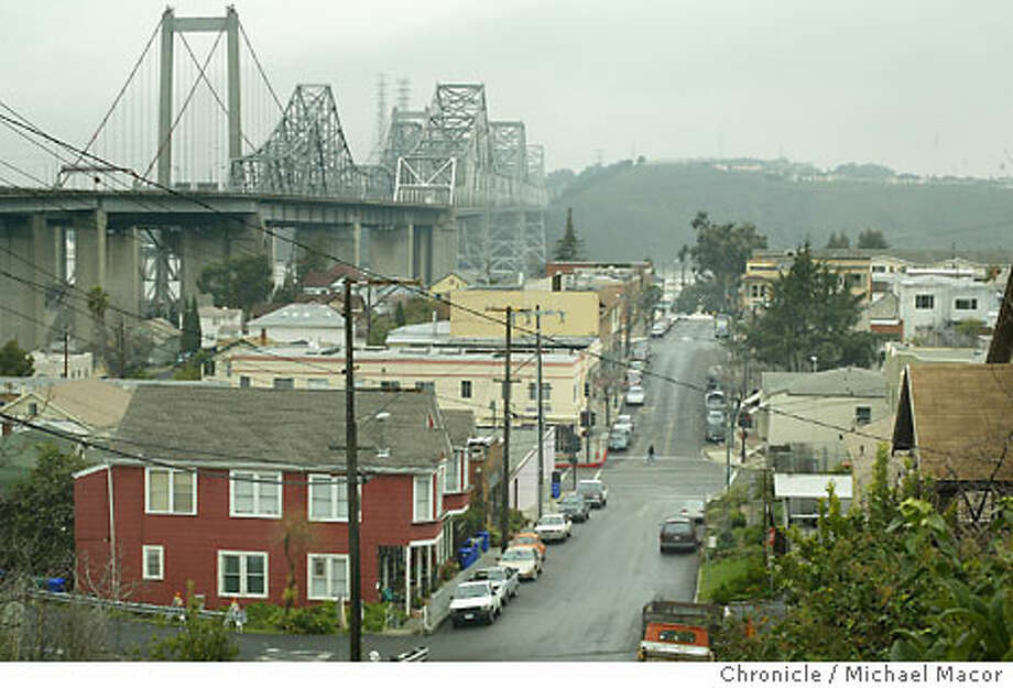 The new Zampa Bridge and the old bridge over the Carquinez Strait can be seen from a hill overlooking Crockett. Chronicle photo by Michael Macor