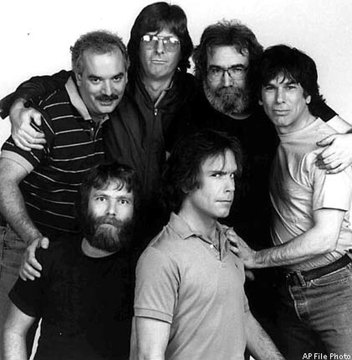 ** FILE ** Members of the Grateful Dead pose in a1985 photo in Marin County, Calif. From left, back row, are Bill Kreutzman, Phil Lesh, Jerry Garcia, and Mickey Hart. In front are Brent Mydland, left, and Bob Weir. After lead singer Jerry Garcia's death in 1995, the Grateful Dead retired from touring. But every now and then The Other Ones, the band's surviving members, put on a show. Bassist Phil Lesh, guitarist Bob Weir and drummers Bill Kreutzman and Mickey Hart quickly sold 70,000 tickets to two shows Aug. 3-4, 2002 in East Troy, Wis. (AP Photo)