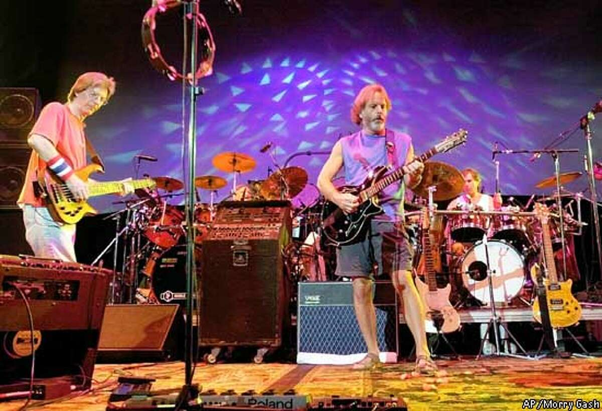 The Grateful Dead perform during a reunion concert Saturday, Aug. 3, 2002, in East Troy, Wis. From left are Phil Lesh, Bill Kreutzmann, Bob Weir and Mickey Hart. (AP Photo/Morry Gash)