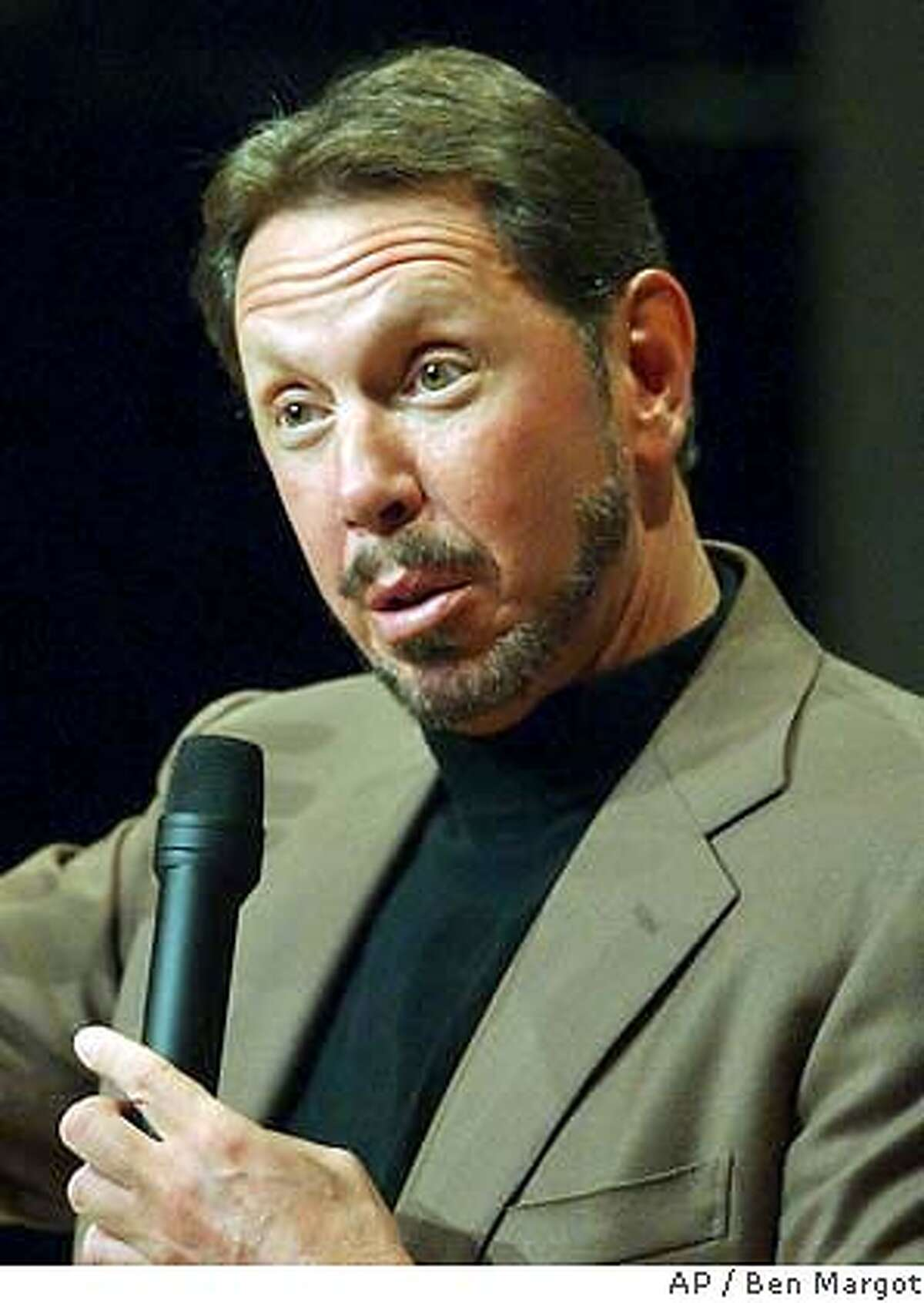 ** FILE ** Oracle Corp. chief executive Larry Ellison fields questions from financial analysts Wednesday, July 9, 2003, during Financial Analyst Day at Oracle headquarters in Redwood Shores, Calif. Ellison Has decided to fight a Justice Department lawsuit blocking his company's $9.4 billion bid for PeopleSoft Inc. (AP Photo/Ben Margot)