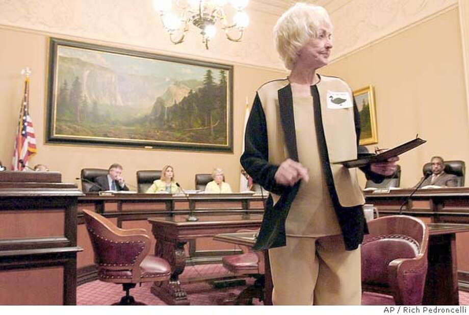 """Actress Bea Arthur turns to leave after testifing before the Senate Business and Professions Committee, in support of a measure by State Senate President Pro Tem John Burton, D-San Francisco, unseen, banning the production and sale of foie gras, a delicacy derived from the livers of force-fed geese and ducks, Monday, April 26, 2004, at the Capitol in Sacramento, Calif. Arthur supported the bill saying """"There is no room in our wonderful state for such a nightmarish industry."""" The committee approved the bill by a 4-1 vote. (AP Photo/Rich Pedroncelli) Photo: RICH PEDRONCELLI"""