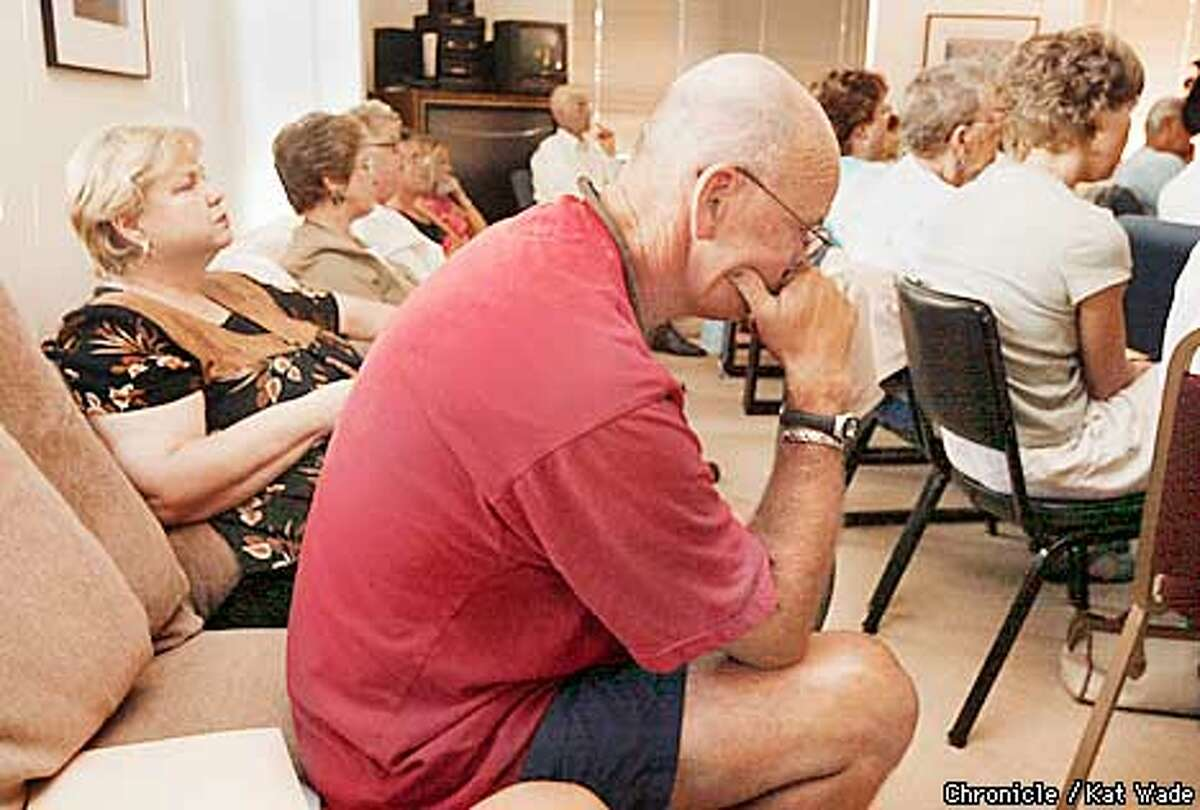 Steve Whitman of Martinez who learned only a week and a half earlier that he has lung cancer listens to DoctorThierry Jahan from the UCSF comprehensive cancer center explaining clinical trials at The Wellness Community in Walnut Creek.. SAN FRANCISCO CHRONICLE PHOTO BY KAT WADE