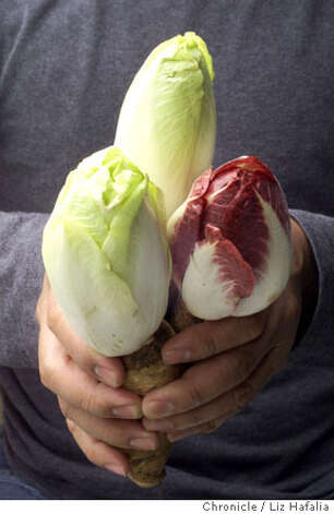 "Endive (ahn-DEEV): Not a lettuce, but an herb, this leafy green is commonly used in salads. Audio: Click here to hear the term ""Endive."" Photo: LIZ HAFALIA"