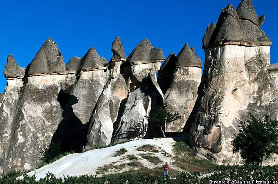 "Cave inns: Bizarre rock formations called ""fairy chimneys,"" some of which are hollowed out and inhabited, are common across Cappadocia, Turkey. Chronicle photo by Deanne Fitzmaurice"