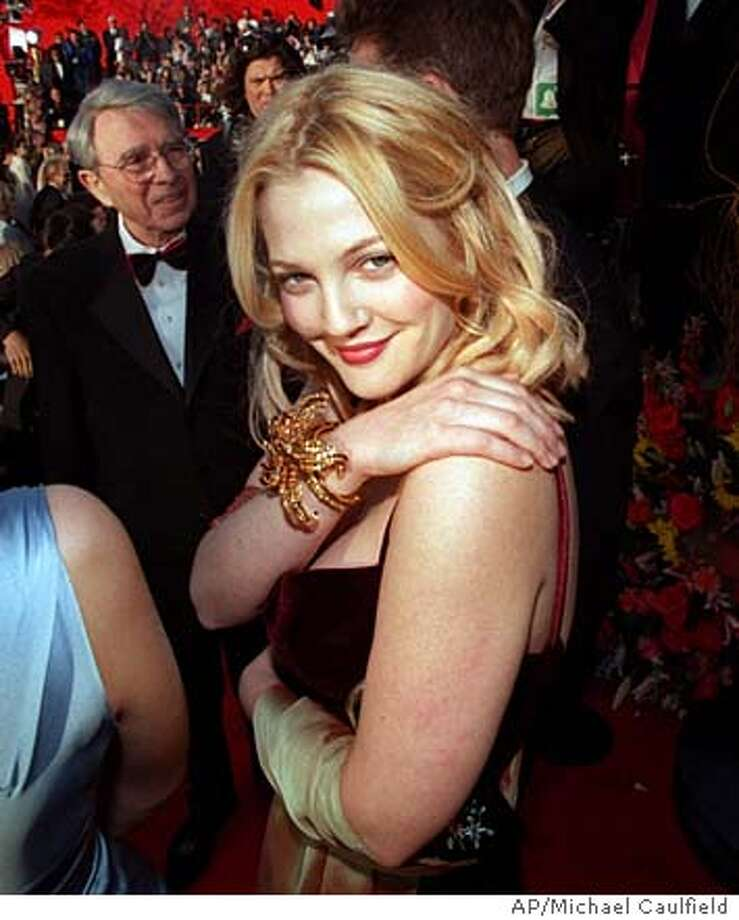 Actress Drew Barrymore poses for photographers as she arrives at the 71st annual Academy Awards ceremony Sunday, March 21, 1999, in Los Angeles. (AP Photo/Michael Caulfield) Photo: MICHAEL CAULFIELD