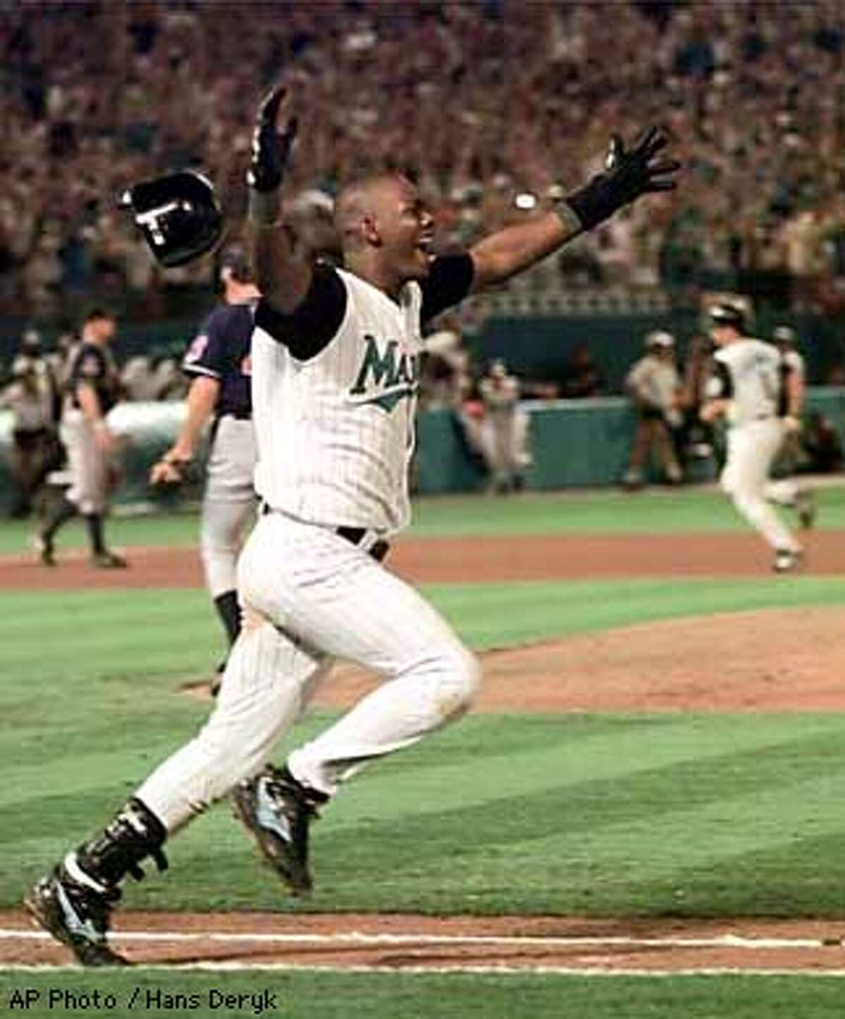 Florida Marlins Edgar Renteria runs down the first base line as his single scores Craig Counsell to win Game 7 and the World Series Sunday, Oct. 26, 1997, at Miami's Pro Player Stadium. The Marlins defeated the Cleveland Indians 3-2. The team ended the 1998 season with the worst record in baseball. The franchise returned to champion status in 2003, but by then the 1997 squad had been completely dismantled. (AP Photo/Hans Deryk)