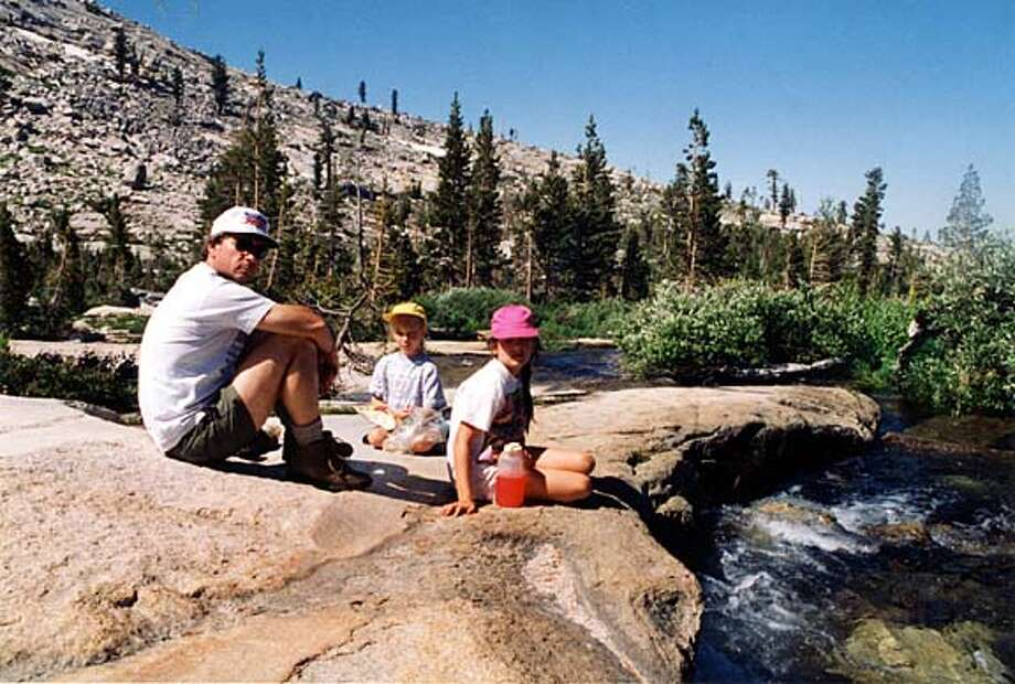 Louis Owens enjoys the Sierra in the early '90s with his daughters Alexandra, center, and Elizabeth. Photo courtesy of the Owens family