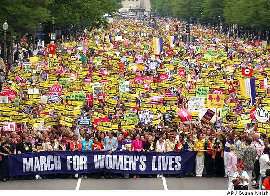 Women march down Pennnsylvania Avenue in Washington, Sunday, April 25, 2004, during a abortion-rights rally and march. The rally, which focused on protecting women's reproductive rights, included men and women from across the country along with activists from nearly 60 countries (AP Photo/Susan Walsh) Photo: SUSAN WALSH
