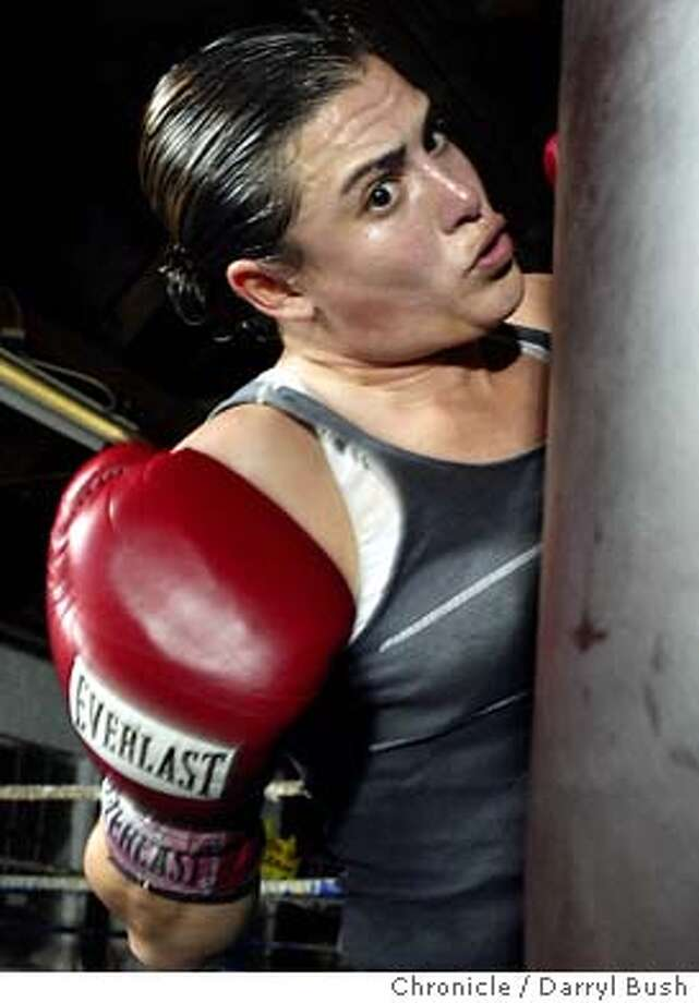 Boxer Eliza Olson, 28, practices combinations including a right uppercut, her favorite punch, into a heavy bag at Gladiators Training Academy. Eliza is grandaughter of former middleweight champion, Bobo Olson.  Event on 2/17/04 in Redwood City.  Darryl Bush / The Chronicle Photo: Darryl Bush