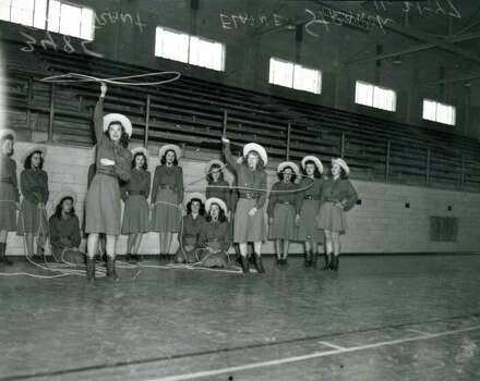 Lassos practice at Thomas Jefferson High School in 1947. Captains Joan Grant (left) and Elaine Strauch in foreground. Photo: Institution Of Texan Cultures / ITC PHOTO