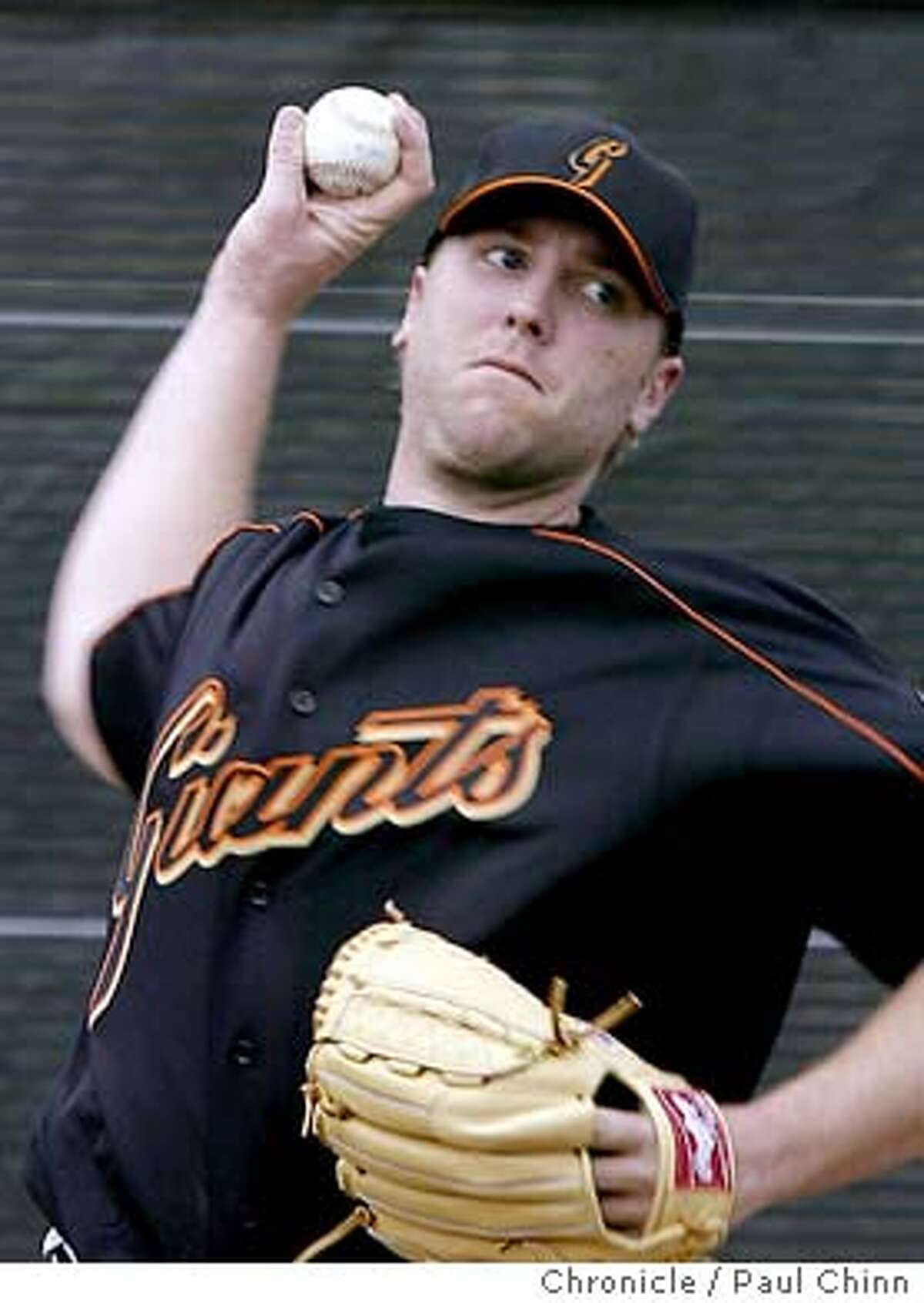giants21_222_pc.JPG New pitcher Brett Tomko pitched for about eight minutes at the workout. The San Francisco Giants held its first 2004 Spring Training workout on 2/20/04 in Scottsdale, AZ. PAUL CHINN / The Chronicle