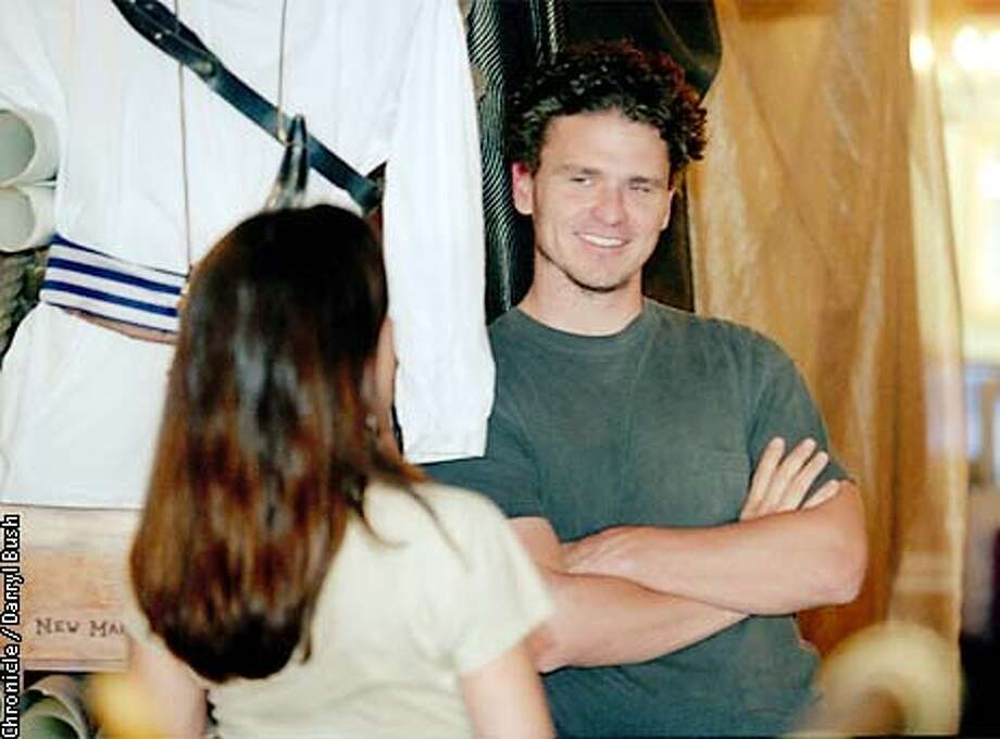 Author Dave Eggers smiles while talking inside to associates at he combination pirate themed retail store and ecucational writing lab, called 826 Valencia in San Francisco. That's a pirate outfit in background left. Chronicle Photo by Darryl Bush Photo: Darryl Bush