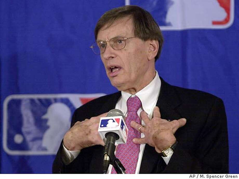 Major League Baseball Commissioner Bud Selig answers qustions at a news conference after receiving a three-year contract extension from Major League Baseball owners during a meeting Tuesday Nov. 27, 2001 at the O'Hare Hilton in Chicago. (AP Photo/M. Spencer Green) DIGITAL IMAGE Photo: M. SPENCER GREEN