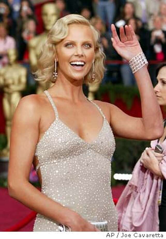 "Charlize Theron arrives for the 76th annual Academy Awards Sunday, Feb. 29, 2004, in Los Angeles. Theron is nominated for best actress in a leading role for her work in ""Monster. (AP Photo/Joe Cavaretta) Photo: JOE CAVARETTA"