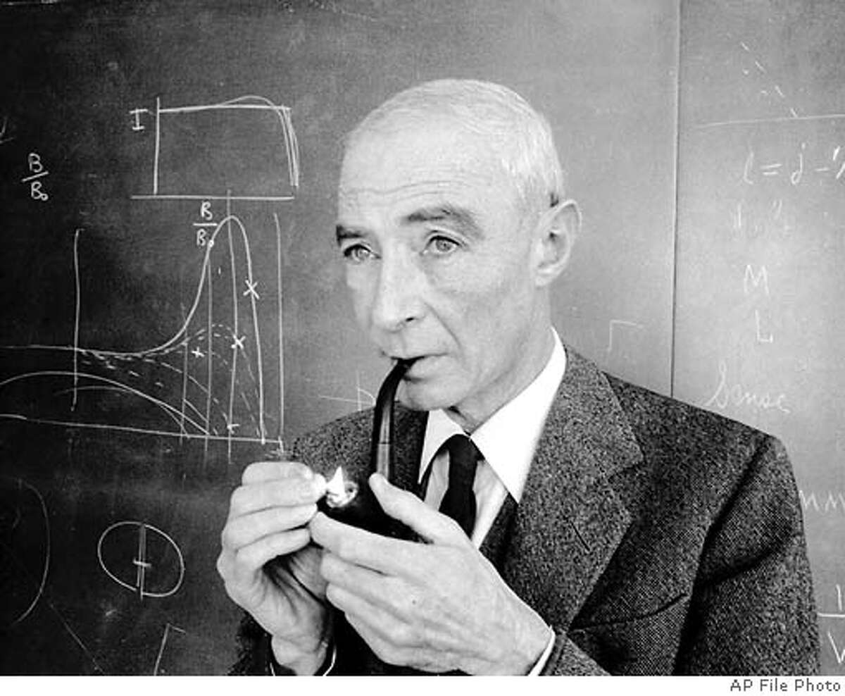 FILE-Atomic physicist Robert lights up his pipe in Princeton N.J., in this 1963 file photo. and other U.S. scientists gave the Soviets information on their efforts to build the first atom bomb, a retired Russian spy says in his memoirs quoted in the April 25th issue of Time magazine. `Since , Bohr and Fermi were fierce opponents of violence, they would seek to prevent a nuclear war, creating a balance of power, through sharing the secrets of atomic energy,'' writes Pavel Anatolievich Sudoplatov in excerpts from ``Special Tasks: The Memoirs of an Unwanted Witness a Soviet Spymaster.'' (AP photo/File)