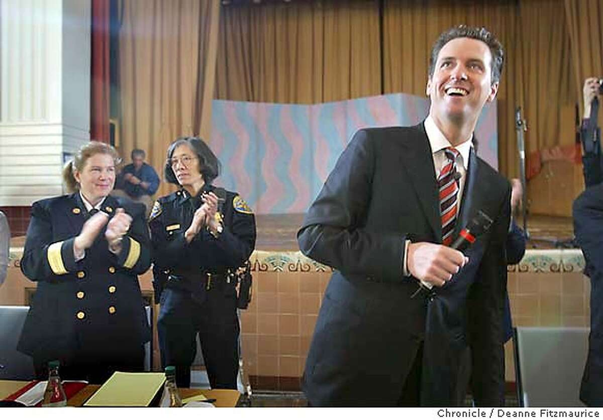 At left, Joanne Hayes-White, Chief SF Fire Department, Heather Fong, Acting Chief, SF Police Dept, and Mayor Gavin Newsom. The mayor gets a warm welcome as he holds a town hall meeting at James Lick Middle School. He has received alot of attention for allowing same-sex weddings at City Hall. Deanne Fitzmaurice / The Chronicle