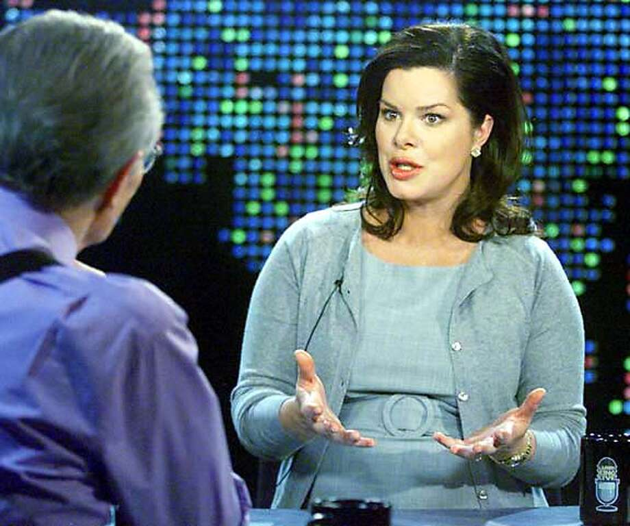 """Oscar nominee Marcia Gay Harden discusses her film """"Mystic River,"""" as she is interviewed by talk show host Larry King (L) during a taping of the CNN program """"Larry King Live,"""" in Los Angeles at the CNN studios February 9, 2004. Harden is nominated as best supporting actress for her role in the film, which is also nominated as best picture. The interview is scheduled to be telecast on CNN February 15, 2004. REUTERS/Rose M. Prouser/CNN/Handout 0 Photo: HO"""