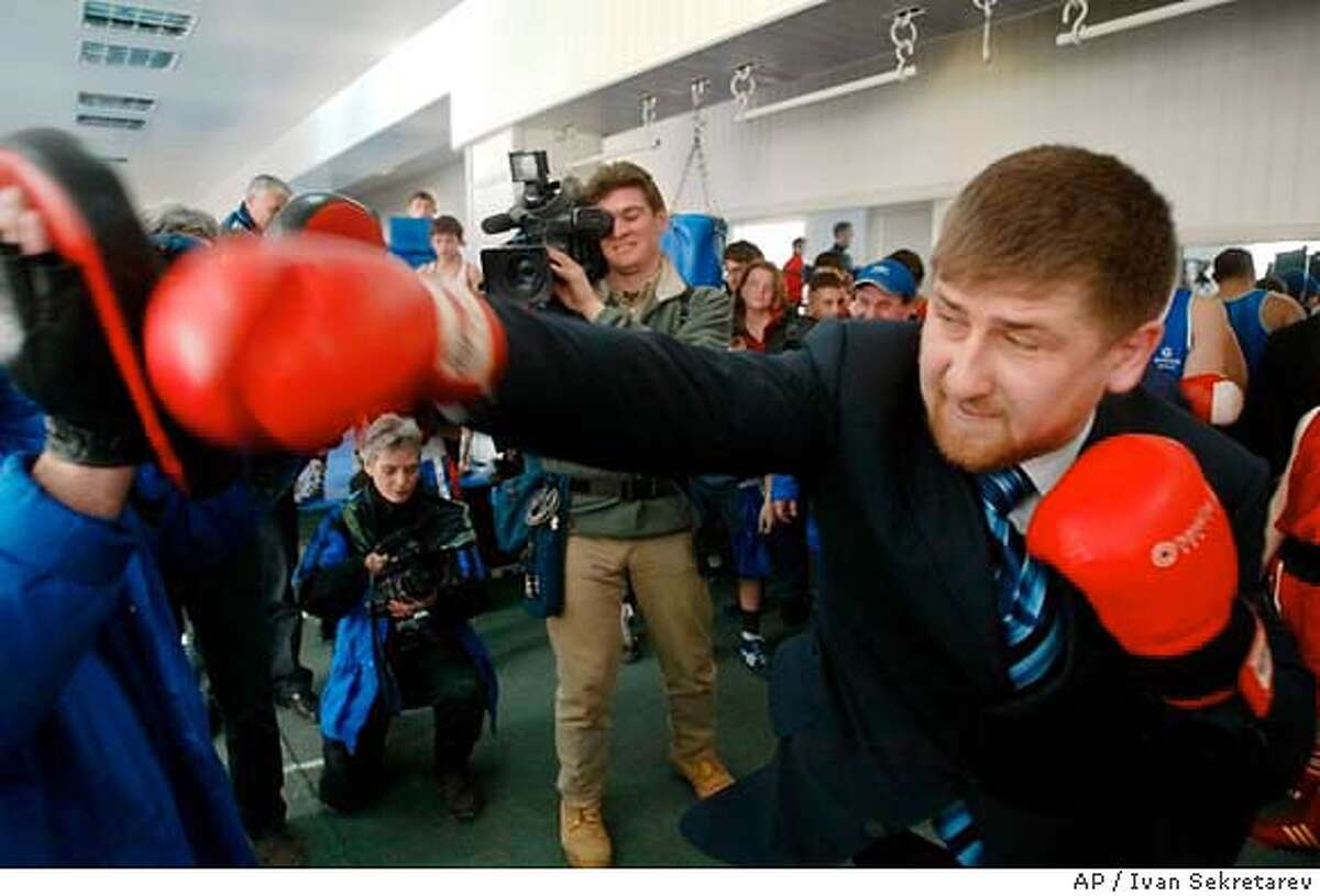 Ramzan Kadyrov, son of Chechnya's president, spars with a boxing coach at the state-funded sports club named in his honor in Gudermes, Russia, Tuesday, Feb. 17, 2004. The younger Kadyrov heads a security force alleged by human rights organizations to be responsible for disappearnaces and detentions in the war-ruined republic. (AP Photo/Ivan Sekretarev) Ramzan Kadyrov, son of Chechnya's president, spars at a sports club in Gudermes, Russia. Ramzan Kadyrov, son of Chechnya's president, spars at a sports club in Gudermes, Russia.