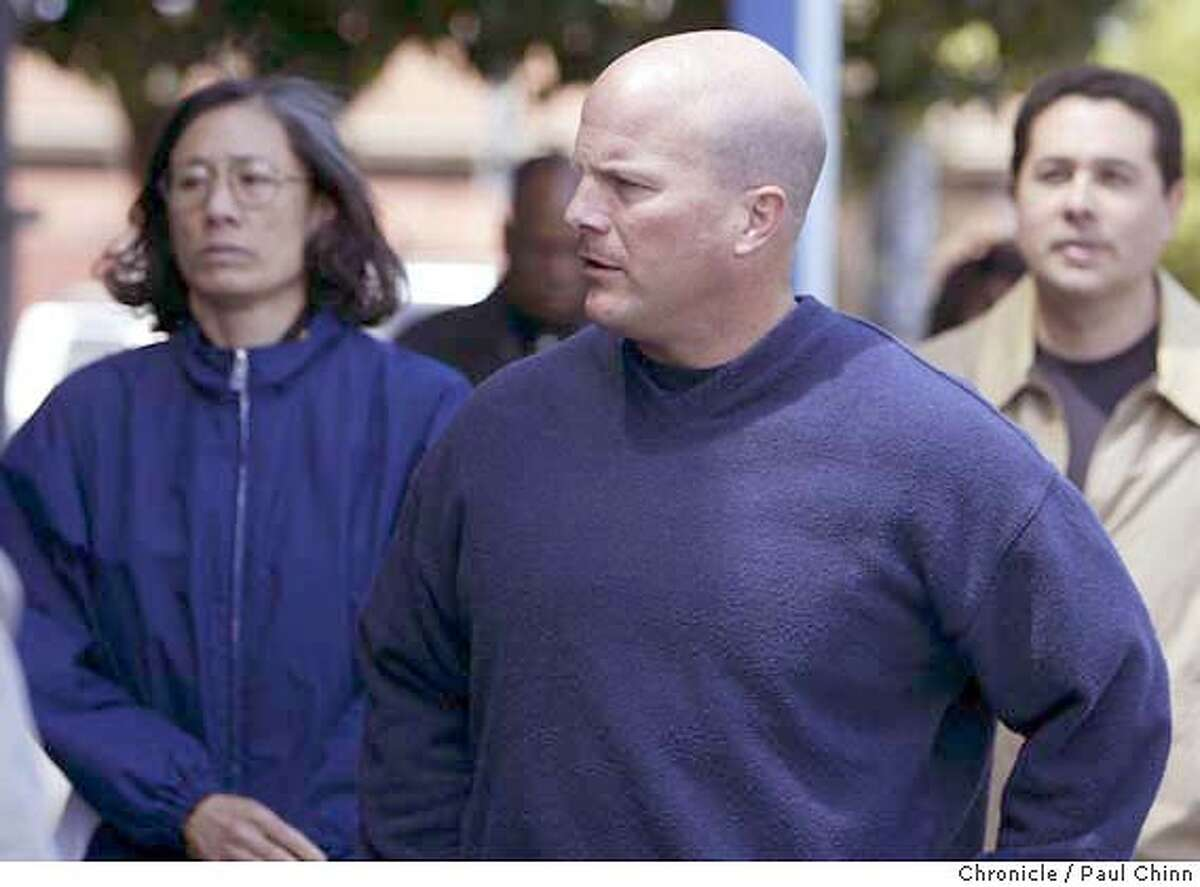 Police chief Heather Fong (left) walked behind deputy chief Greg Suhr on their way to the meeting at SFPOA headquarters. (The man at far right is unidentified). The SF Police Officer's Association and DA Kamala Harris hold separate news conferences to comment on police officer Isaac Espinoza's shooting death on 4/21/04 in San Francisco. PAUL CHINN/The Chronicle