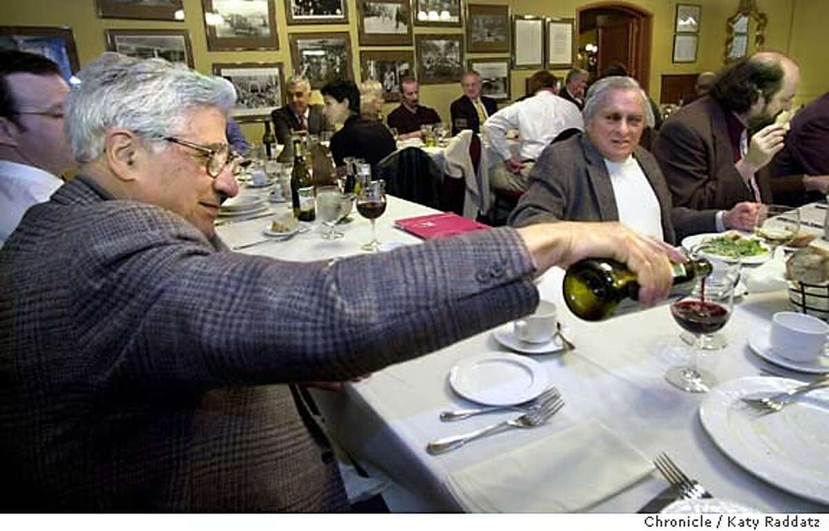 SHOWN: At the weekly luncheon meeting of Il Cenacolo at Fior d'Italia restaurant in North Beach, host Rocco Guilli keeps the wine flowing. Il Cenacolo is the generous Italian men's group who quietly and consistently supports the arts. They have lunch each Thursday at Fior d'Italia in North Beach. Shoot date is 2/19/04; writer is Stephanie Salter. Katy Raddatz / The Chronicle