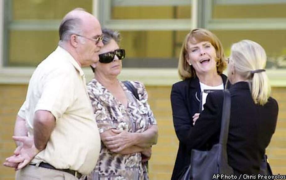 Delbert Stayner, left, and his wife Kay, 2nd from left, talk with their son's attorney, Marcia Morrissey, second from right, and an unidentified member of the defense team, outside of Santa Clara Superior Court during the penalty phase of Cary Stayner's murder trial on Thursday, October 3, 2002. Kay and Delbert Stayner testified as character witnesses in the penalty phase of their son's murder trial. Stayner, already serving a life sentence for the 1999 murder of Joie Armstrong, faces the death penaltyfor the murders of Carole and Juli Sund and Sylvina Pelosso. (AP Photo/Chris Preovolos) Photo: CHRIS PREOVOLOS