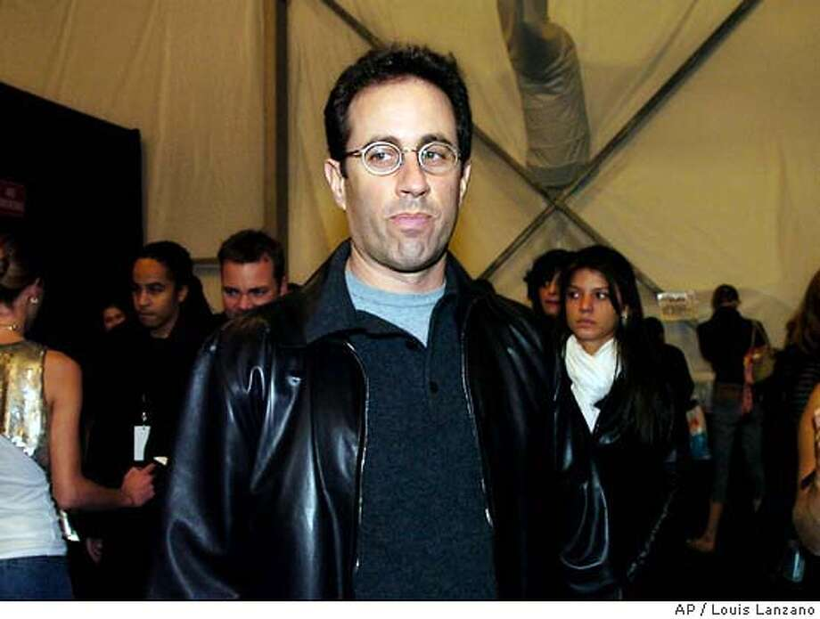 Jerry Seinfeld arrives backstage before the start of the Narciso Rodriguez Fall/Winter 2004 collection, Tuesday, Feb. 10, 2004, in New York. (AP Photo/Louis Lanzano) Photo: LOUIS LANZANO