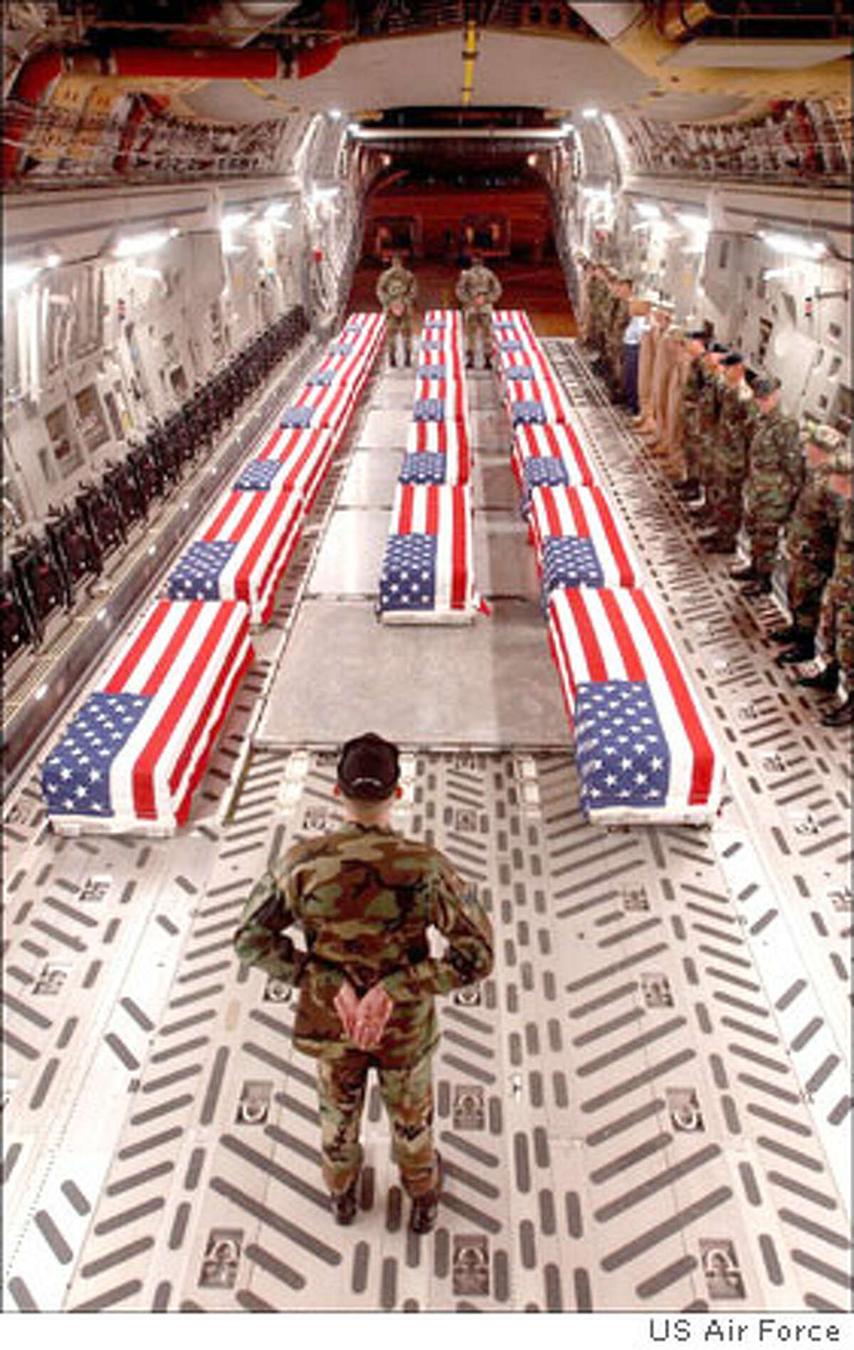 Military coffins with casualties from Iraq arrive at Dover (Del.) Air Force Base. Photo courtesy of U.S. Air Force