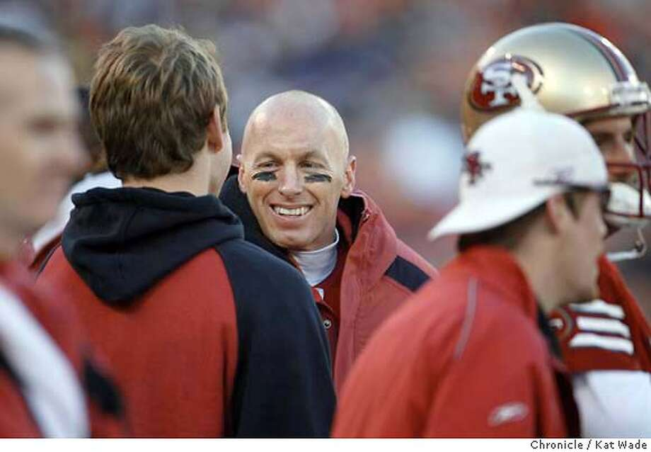49ERS_0606_KW.jpg While The San Francisco 49er's backup quarterback finishes the game, a pleased Jeff Garcia chats with teammates on the sidelines and begins to celebrate their 50 to 14 win over the Arizona Cardinals at Candlestick Point on Sunday 12/7/03 in San Francisco . Kat Wade / The Chronicle Jeff Garcia threw four touchdown passes and ran for another two scores in the rout of the Cardinals at Candlestick Park. Jeff Garcia threw four touchdown passes and ran for another two scores in the rout of the Cardinals at Candlestick Park. Jeff Garcia threw four touchdown passes and ran for another two scores in the rout of the Cardinals at Candlestick Park. Photo caption 49ers08_ph21070668800The Chronicle49ERS_0606_KW.jpg_ While The San Francisco 49er's backup quarterback finishes the game, a pleased Jeff Garcia chats with teammates on the sidelines and begins to celebrate their 50 to 14 win over the Arizona Cardinals at Candlestick Point on Sunday 12-7-03 in San Francisco .__Kat Wade - The Chronicle__MANDATORY CREDIT FOR PHOTOG AND SF CHRONICLE- -MAGS OUT CAT MANDATORY CREDIT FOR PHOTOG AND SF CHRONICLE/ -MAGS OUT Photo: Kat Wade