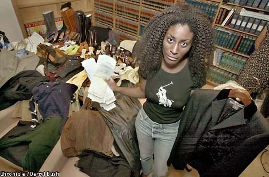 Employee Toni Young shows Polo Ralph Lauren clothing that she had to buy and wear.