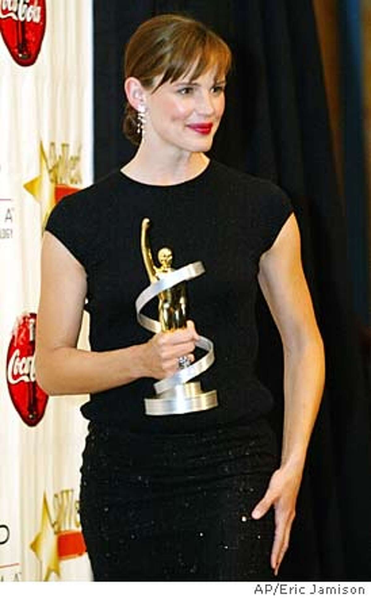 Actress Jennifer Garner poses for photographers during at The Paris Hotel & Casino Thursday, March 25, 2004, in Las Vegas. Garner won the Female Star of Tomorrow award. (AP Photo/Eric Jamison)
