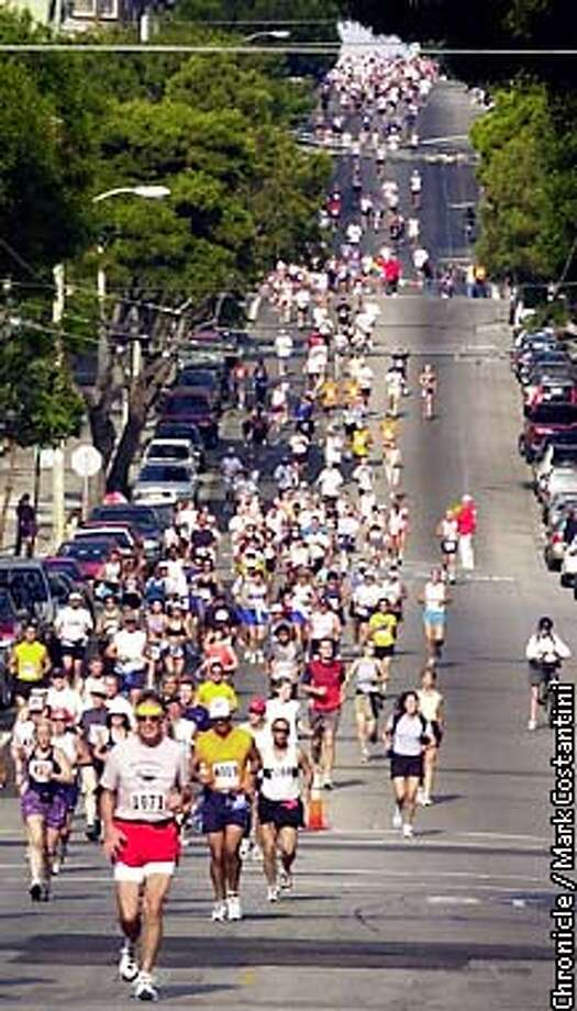 RUNNERS ON HAIGHT STREET DURRING THE SAN FRANCISCO MARATHON. Photo: Mark Costantini/SF Chronicle Photo: MARK COSTANTINI