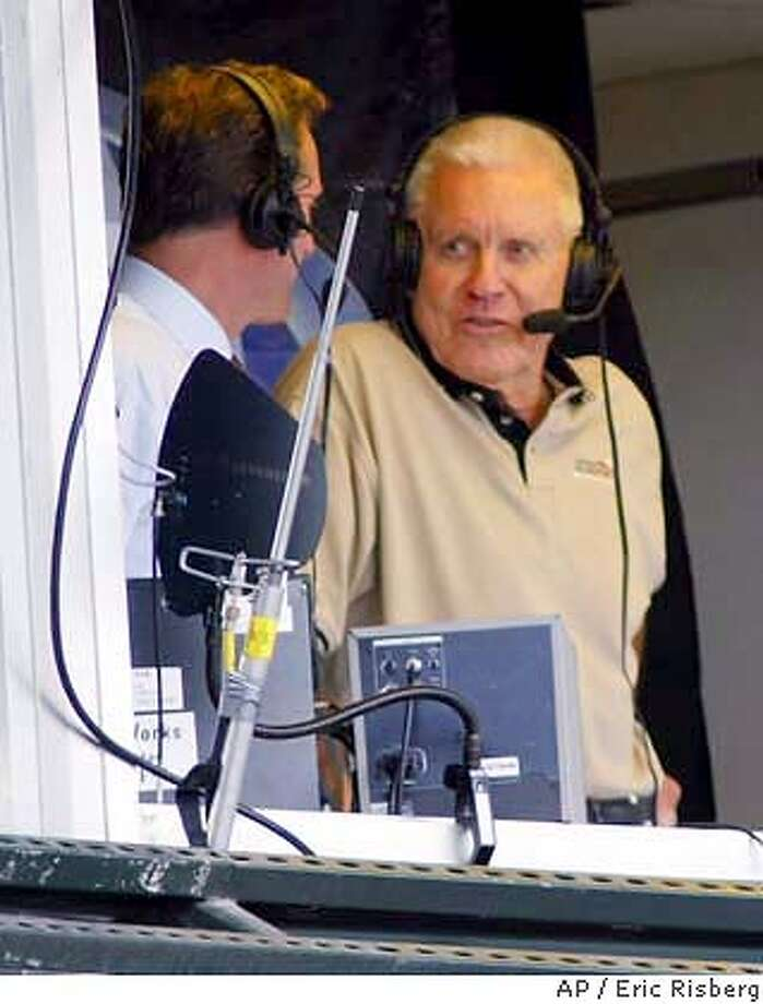 San Francisco Giants' broadcaster Lon Simmons, right, makes one of his final regularly scheduled appearances in the broadcast booth during the 8th inning of the Giants' game against the Houston Astros in San Francisco, Saturday Sept. 28, 2002. Simmons is making his last regularly scheduled broadcast on Sunday. Simmons joined the Giants in their charter 1958 season teaming with Hall of Famer Russ Hodges..(AP Photo/Eric Risberg) ALSO RAN: 12/12/03 CAT Photo: ERIC RISBERG