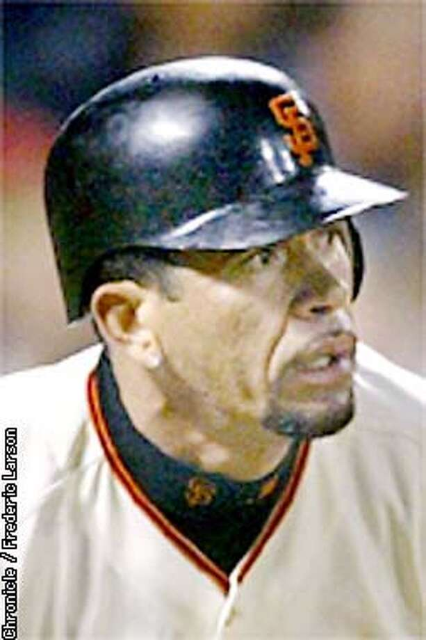GIANTS2-C-24SEP02-SP-FRL: Giants Benito Santiago smashes a triple to score two runs in the 3rd inning against the San Diego Padres at PacBell Park SF. Chronicle photo by Frederic Larson Photo: Frederic Larson