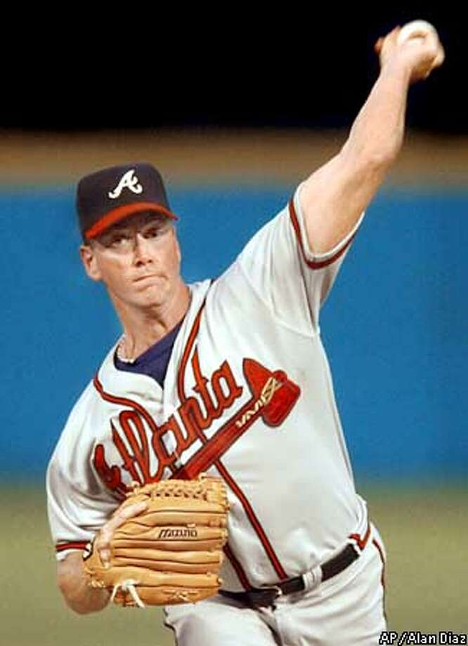 Atlanta Braves' Tom Glavine pitches against the Florida Marlins in the first inning Saturday, Sept. 14, 2002, in Miami. (AP Photo/Alan Diaz) Photo: ALAN DIAZ