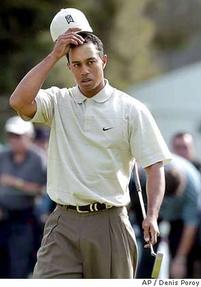 A relieved Tiger Woods removes his hat after winning the final two holes with birdies to earn a one up victory over John Rollins in the opening round at the World Golf Championships Accenture Match Play Championship Wednesday Feb. 25, 2004 in Carlsbad, Calif. (AP Photo/Denis Poroy) Photo: DENIS POROY