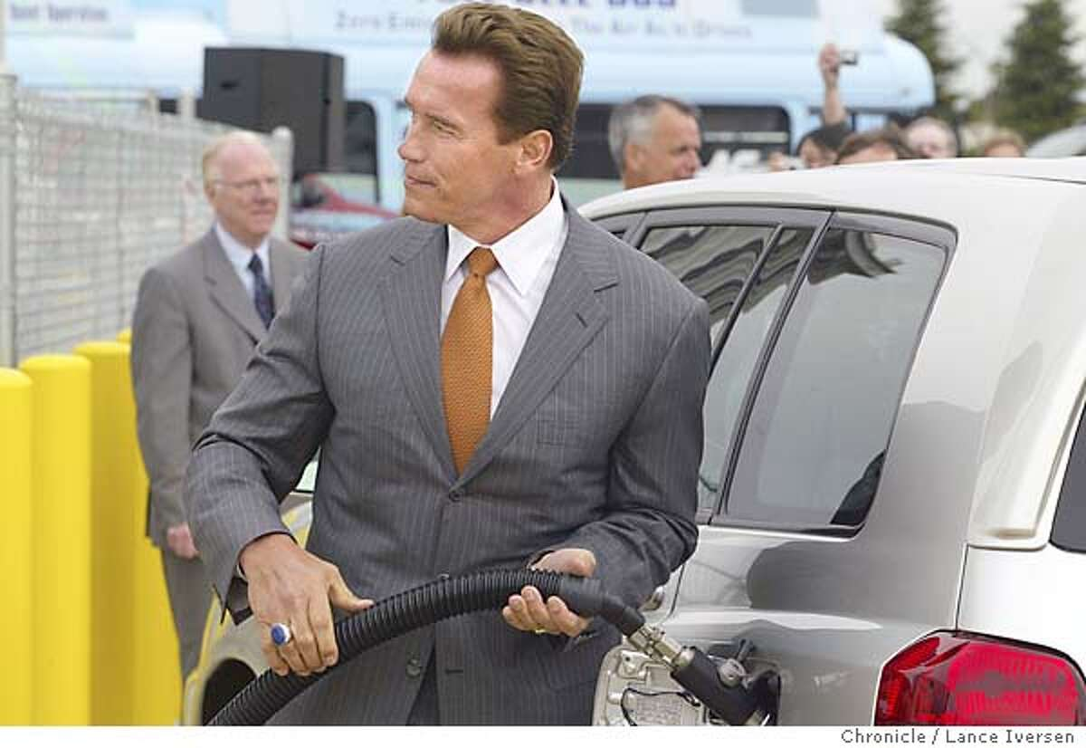 HYDROGEN027_LI.JPG event on 4/20/04 in DAVIS Gov. Arnold Schwarzenegger fuels a fuel cell vehicle before signing the California Highway Network initiative during a ceremony at a refueling station on the University of California Davis campus Tuesday, April 20, 2004. The initiative will support a rapid transition from petroleum to fueled transportation. Lance Iversen/The San Francisco Chronicle