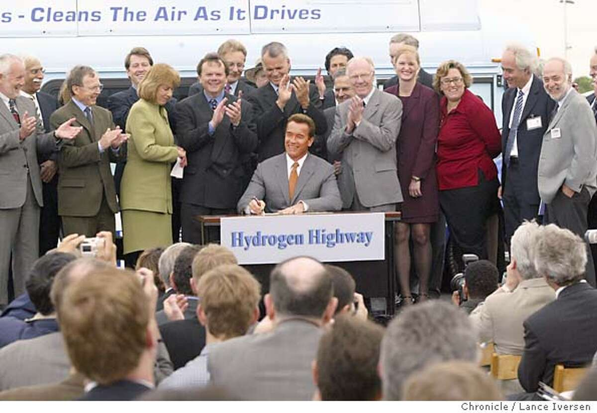 HYDROGEN127_LI.JPG event on 4/20/04 in DAVIS California Gov. Arnold Schwarzenegger signs the California Highway Network initiative during a ceremony at a refueling station on the University of California Davis campus, Tuesday, April 20, 2004, in Davis, Calif. By Lance Iversen/The San Francisco Chronicle