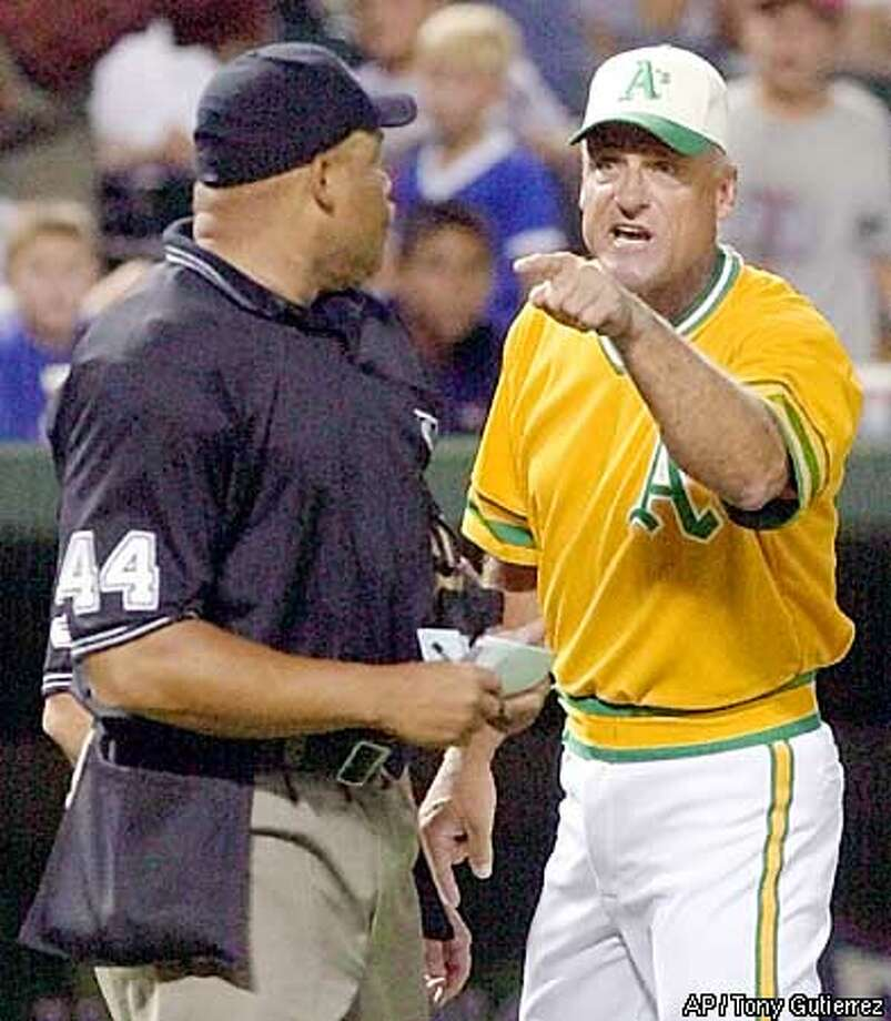 Oakland Athletics head coach Art Howe, right, argues with homeplate umpire Kerwin Danley (44) in the eighth inning in the 10-6 Athletics loss to the Texas Rangers Saturday July 27, 2002, at the Ballpark in Arlington, Texas. Howe was ejected following the argument. (AP Photo/Tony Gutierrez) Photo: TONY GUTIERREZ