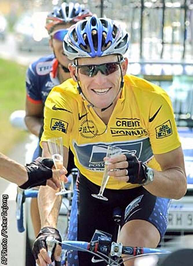 Overall leader Lance Armstrong of Austin, Texas, toasts champagne with an unidentified teammate during the final stage of the Tour de France cycling race between Melun and Paris Sunday, July 28, 2002. AP Photo / Peter Dejong Photo: PETER DEJONG