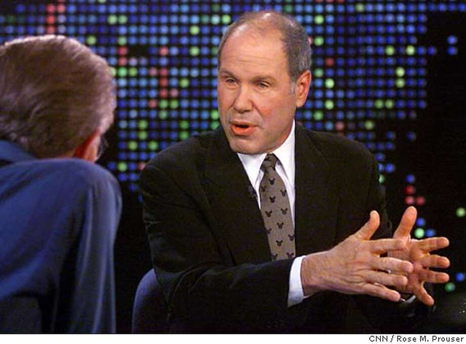 "Michael Eisner, CEO and chairman of the Walt Disney Company gives his first interview since Comcast Corp.'s hostile takeover bid with talk show host Larry King (L) on the CNN program ""Larry King Live"" in Los Angeles at the CNN studios February 20, 2004. Einser discussed the health of the company and their planned purchase of the 'Muppet' characters from the Jim Henson Company. Rose M. Prouser/CNN 0 Photo: HO"