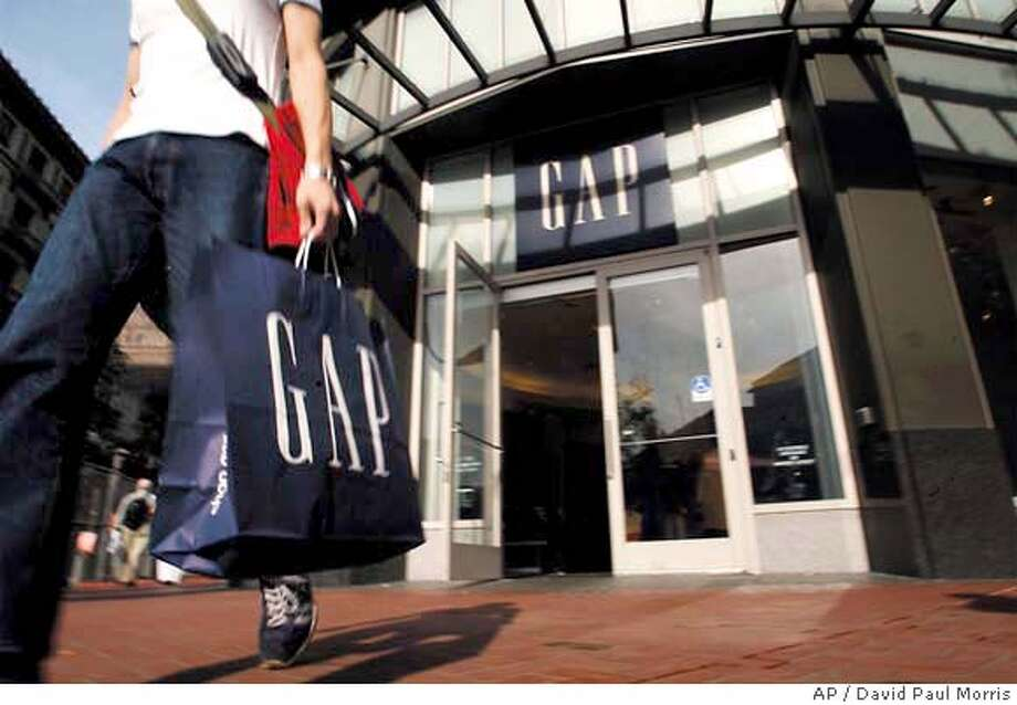 ** FILE ** A shopper leaves a Gap store in San Francisco, Tuesday, Nov. 12, 2002. In a press release Thursday, Feb. 26, 2004, the Gap said net income for the fourth quarter rose to $355.8 million (AP Photo/David Paul Morris) Photo: DAVID PAUL MORRIS